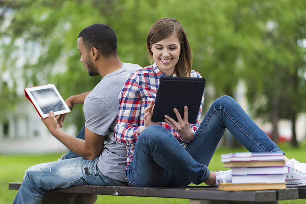 Student Couple Study On The Bench